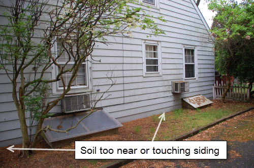 soil on wood siding